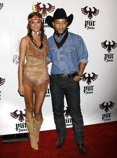 John Legend and Chrissy Teigen Photos Photos - Kim Kardashian and Reggie Bush at the Pur Jeans Halloween Bash, STK, West Hollywood, CA. - Pur Jeans Halloween Bash