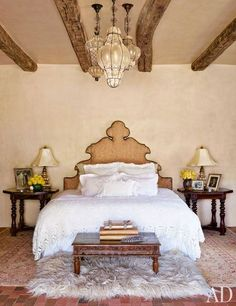 In Jane Fonda's New Mexico ranch house - The actress designed the headboard in the master bedroom; the bed linens are vintage, and the ceiling fixtures are Italian.