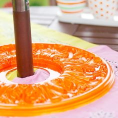 DIY Ideas | Awesome idea to use a painted ceiling medallion to add a pop of color to an outdoor table and hold down a tablecloth!