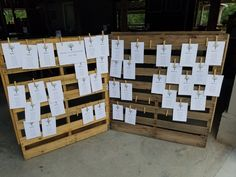 Cards with Name and infromaion hanging from clothes pins and twine on wooden pallets