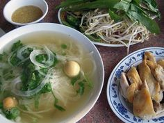 Pho ga with white chicken side, unlaid chicken eggs, and ginger fish sauce.