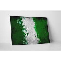 Decorate your home and show your patriotism with this wrapped canvas wall art featuring a vintage depiction of the Nigerian flag. This artwork is printed with Epson Ultra-Chrome inks to resist moistur