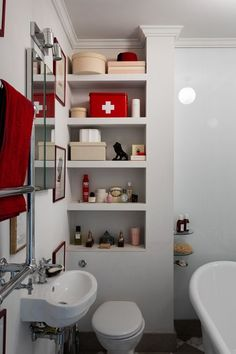 Small bathroom storage solution in a shape of built in shelves