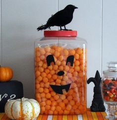 Convert an oversized cheese ball container into a smiling jack-o'-lantern that will add instant festivity to your party buffet. This is perfect for a casual party, a party at work, or anywhere cheese balls are an acceptable party food. I found this giant tub of cheese balls at Target for about $4.99. I so want to buy this and make it. I even have a black bird I found at the Dollar Tree...lol
