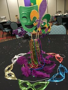 Mardi Gras Centerpieces with mask cutouts and beads