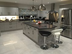 Grey shaker Island with Steel Grey leathered granite worktop and barstools. Kitchen supplied by DIY Kitchens - Broadoak painted in F&B 275 Purbeck Stone Modern Shaker Kitchen, Modern Kitchen Cabinets, Kitchen Worktop, Kitchen Units, Kitchen Doors, Kitchen Paint, Kitchen Flooring, Kitchen Interior, Black Granite Kitchen