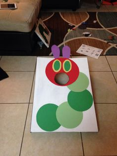 Bean bag toss DIY very hungry caterpillar. Made from a science project board.