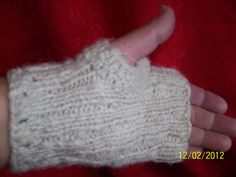 Handspun wool fingerless gloves. $20.00, via Etsy.