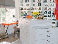 Swoon-worthy! Wow! Love the island and vanity area in the closet and the shoe wall!