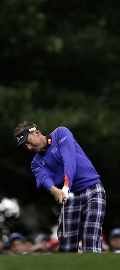 Ian Poulter, of England, tees off on the fourth hole during the second round the Masters golf tournament Friday, April 6, 2012, in Augusta, Ga.