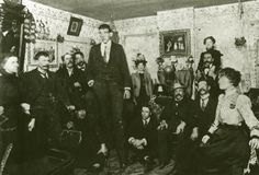 """Édouard Beaupré, Mr. Patenaude, 2nd from left; Andre """"La Bosse"""" Gaudry, seated 3rd from right on tour in Winnipeg"""