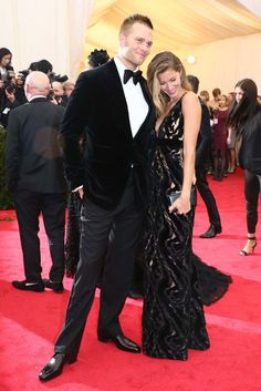 Tom Brady in Tom Ford and Gisele Bündchen in Balenciaga. [Photo by Evan Falk]
