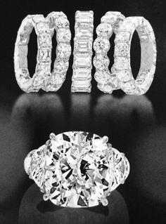 Another stunning set from Daniel Levy Jewelry!  http://www.daniellevyjewelry.com/   Top: Platinum eternity rings with asscher, round, emerald and radiant cut diamonds.  Bottom: Platinum engagement ring with a ten carat cushion shape center diamond and half moon shape side diamonds