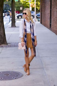Katie's Bliss styles a corduroy skirt, plaid scarf, Rag & Bone booties and Tory Burch leather crossbody bag for fall weather.