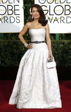 Golden Globes Best Dressed:  Selma Hayek in an Alexander McQueen ivory gown with a metallic grey belt, an Alexander McQueen clutch and Boucheron jewelry #GoldenGlobes2015