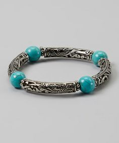 Take a look at this Silver & Turquoise Scroll Stretch Bracelet by Fantasy World Jewelry on #zulily today!