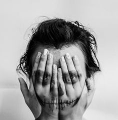 """fig.: The ghostly image of a girl with hands in front of her face was photographed and later re-worked by South-African Laura Schmid. Laura Schmid explains the making of 'Hide and Seek': """"I layered two photographs over each other getting the effect of the girl's face over her hands, converted the photo to BnW and changed the contrast and brightness."""" Photo: 'Hide and Seek' (C) Laura Schmid, South Africa; shortlist 'Youth' (Portraits), Sony World Photography Awards 2014."""