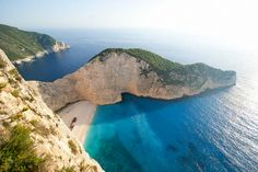 Welcome to Navagio Beach aka Shipwreck Cove on Zakynthos Island, Greece. One of the most beautiful places on the planet. Welcome to Navagio Beach aka Shipwreck Cove on Zakynthos Island, Gre Most Beautiful Beaches, Beautiful Places In The World, Amazing Places, Greece Vacation, Vacation Spots, Greece Honeymoon, Vacation Rentals, Palm Beach, Top 10 Honeymoon Destinations