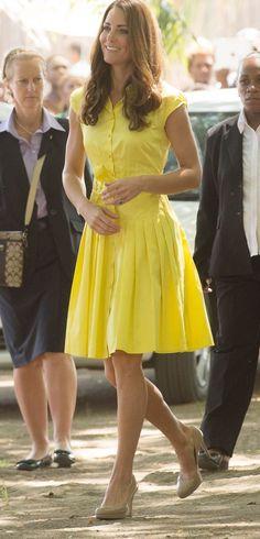 Duchess of Cambridge Kate Middleton wears a yellow Jaeger shirt dress during 2012 royal tour