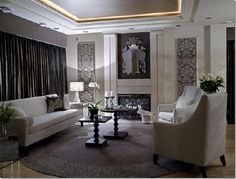 fab grey living room. love the cove lighting and wallpaper inserts.