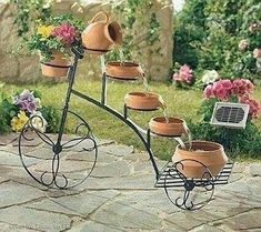 bicycle used for making a water fountain and garden decoration Uhles Van Winkle Myers Design Fonte, Water Fountain Design, Fountain Ideas, Garden Fountains, Water Fountains, Fountain Garden, Outdoor Fountains, Water Garden, Plant Decor