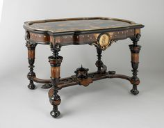 Renaissance Revival table, late 19th century. Photo by John Faier, © The Richard H. Driehaus Museum.
