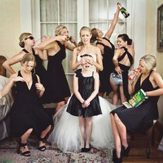 A non-traditional take on the bride's picture with the flower girl & bridesmaid's. So funny! Bride shielding the flower girl's eyes from the bridesmaid's behavior!