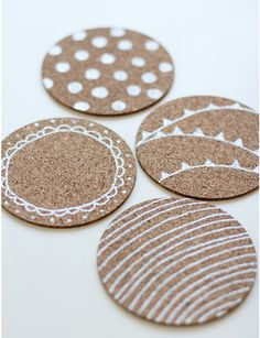Decorated cork coasters or hot plates w/ Sharpie pen...  http://bargainhoot.com/wp-content/uploads/2012/07/Screen-shot-2012-07-28-at-10.33.13-AM.png