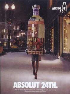 Absolut 24th. 25 years	    Woman walking with pile of Christmas presents