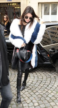 Kendall Jenner keeps it glam chic while hitting the streets of Paris. See more of the off duty model looks here: