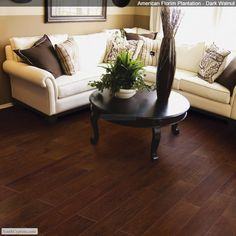 Dark Walnut porcelain wood tile! This is a must for households like ours with big dogs! The elegance of hardwood flooring, but the resilience of tile!