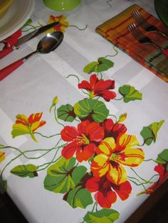 Vintage table cloth  nasturtiums! OMG!  If I ever see this table cloth, I am NOT cutting it up.