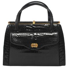 Elizabeth Arden 1960s Black Alligator Handbag | From a collection of rare vintage handbags and purses at https://www.1stdibs.com/fashion/accessories/handbags-purses/
