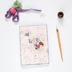 Pastel Pink Wedding Guest Book with custom initials flowers
