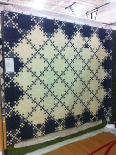 Double Nine-Patch quilt. Reversing colors in the perimeter blocks makes the quilt appear to have a border,