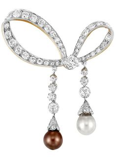 Tiffany & Co. Belle Epoque Natural Saltwater Pearl Bow Brooch, circa 1900-1910. Belle Epoque Tiffany & Co. brooch with two natural saltwater pearls with a looped diamond-set bow centering one old European-cut diamond approximately 0.40 ct., suspending two lines of diamonds, tipped by one pinkish-brown pearl approximately 7.41 x 7.12 mm., and one pearl approximately 7.46 mm., capped by rose-cut diamonds, totaling 52 old European-cut diamonds 2.90 cts., signed Tiffany & Co., circa 1905.