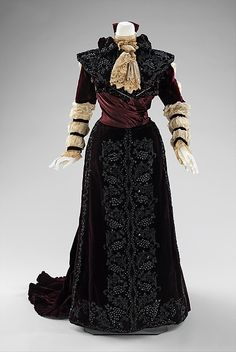 This dress is in keeping with the interest in historical revivals popular in the 19th century. The long puffed sleeves refer to both Elizabethan and early 19th-century styles. The one-piece construction indicates it was probably intended for formal reception at home.