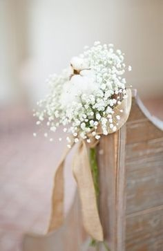 Babies breath aisle flowers with gold ribbon, might be a good idea to use something like this to rope off and decorate the edge of the garden fences with