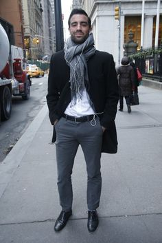 Shop this look on Lookastic:  http://lookastic.com/men/looks/scarf-overcoat-dress-shirt-belt-chinos-derby-shoes/7849  — Grey Scarf  — Black Overcoat  — White Dress Shirt  — Black Leather Belt  — Charcoal Chinos  — Black Leather Derby Shoes