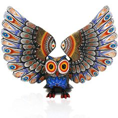 Gorgeous owl woodcarving by Oaxacan artist Luis Sosa. This magnificent <strong>buho</strong> is spectacularly painted...just look at those wings!