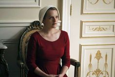 """This image released by Hulu shows Elisabeth Moss as Offred in a scene from, """"The Handmaid's Tale,"""" p... - The Associated Press"""