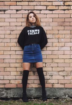 """20 Modern Ways to Style a Denim Skirt for Spring - edgy """"femme fatale"""" graphic sweatshirt worn with a tight denim mini skirt + knee high socks"""