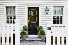 Front Porch Stairs, Parachute Home, Terrace Floor, Stained Glass Door, Yellow Houses, White Houses, Built In Bench, Design Within Reach, House Entrance