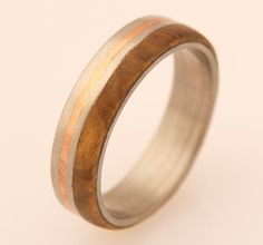 titanium wood ring olivewood inlay by aboutjewelry on Etsy, $220.00