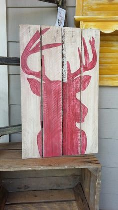 Painted pallet piece. Elk head over white, distressed, and aged with dark stain.