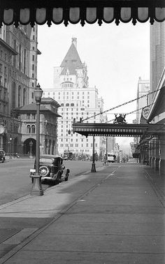 Looking west along Georgia Street [from Granville Street] towards the third Hotel Vancouver 1930  by City of Vancouver Archives