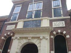 House facade with text en AD1683 Leiden