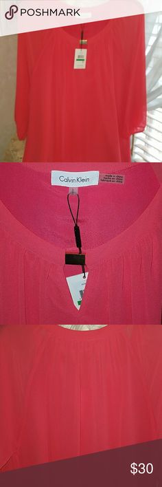 Calvin Klein Coral blouse Calvin Klein Coral blouse with a sheer 3/4 sleeve and Center lined. Beautiful and lightweight can be dressed up or dressed down for any occasion just spring cleaning. Shirt is 26 and a half inches long ,  from armpit to armpit is 21 and a half inches wide . Shoulder to shoulder is 18 in wide . Calvin Klein Tops Blouses