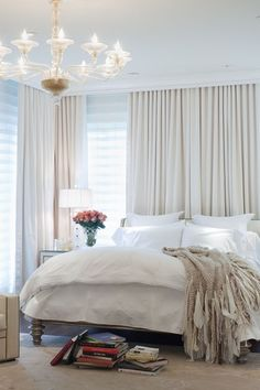 Note corner window treatment - with Ceiling-to-Floor window and wall treatments, including the wall near window as backdrop for bed. Possibly mirror this on left slider wall as well? Excellent way to deal with awkward window and furniture placements in master bedroom.