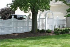 scalloped vinyl semi-private fence with arbor